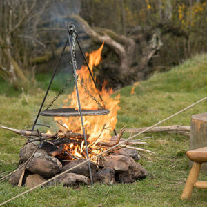 Fire tripod for campfire cooking. Camping and glamping Cornwall and South West