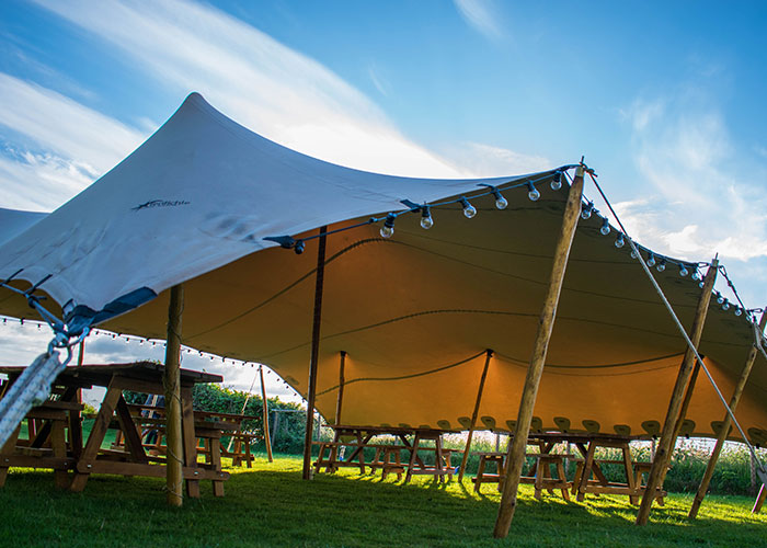 The stretch tent cool canvas tent company for Colorado canvas tent
